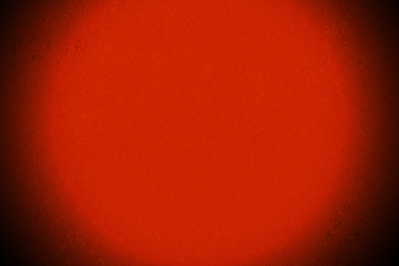 bright center: Abstract red background with bright center spotlight