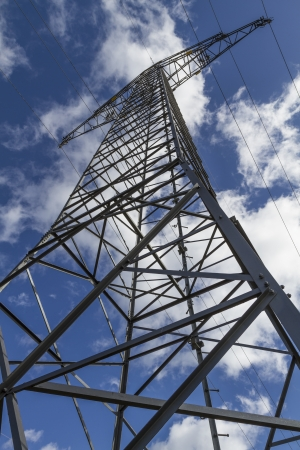 energy suppliers: Electrical tower closeup against blue sky Stock Photo