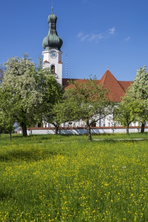 Typical bavarian church and spring meadow photo