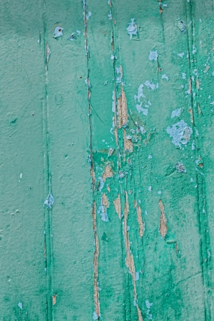 spall: Wooden green painted fence as grunge background