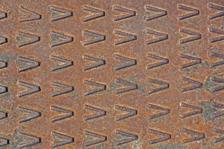 Rusty used metal diamond plate as background photo