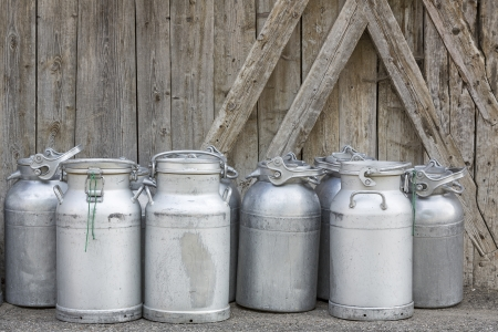 Vintage milk cans in rural Northern Italy photo