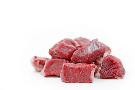 cubed: Pieces of raw beef goulash with shallow