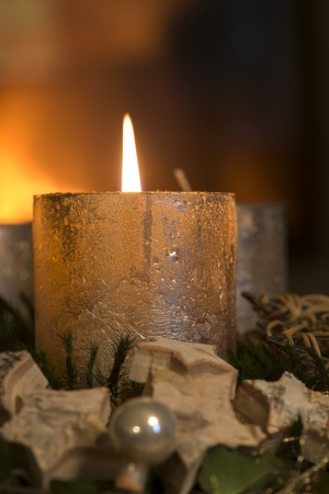 Burning candle on an advent wreath photo