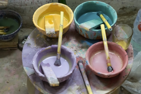 Paint pots seen in a pottery in Morocco photo