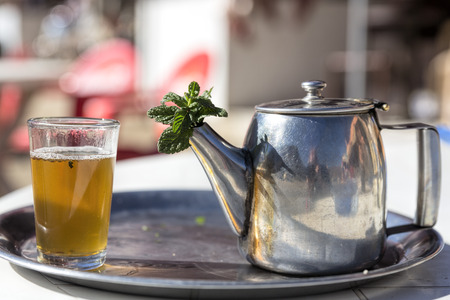Mint tea in a glass and pot, Morocco photo