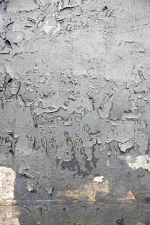 Weathered gray paint on metal as background photo