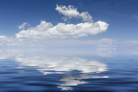 costal: White clouds over the Mediterranean sea, reflections