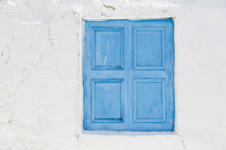 Closed painted window blinds in Greece photo