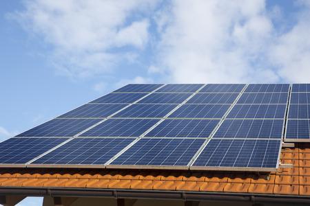Solar panels on a brick roof Standard-Bild