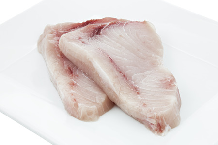 Two pieces of raw swordfish on a plate Stock Photo