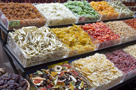 Dried fruits on display on a market photo