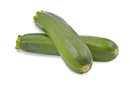 courgettes: Ripe courgettes on white background Stock Photo