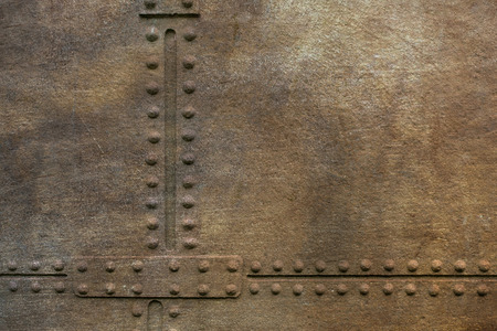 rivets: Grunge metal plate with rivets as background