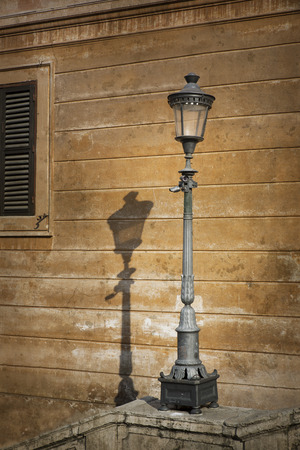 shaddow: Single metal retro lamp post in Rome, Italy Stock Photo