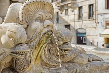 stone cutter: Sculpture on the Giacomo della Porta fountain in Rome, Italy