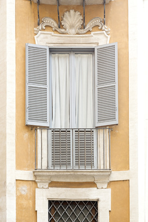 residential house: Window with shutters on a residential house in Rome, Italy Stock Photo