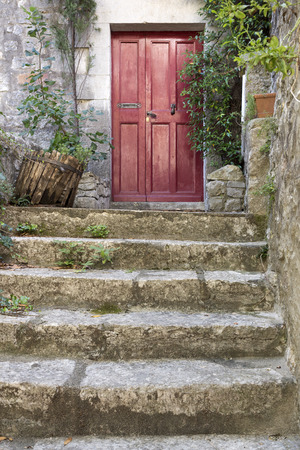 stone stairs: Old stone stairs with entrance door Stock Photo