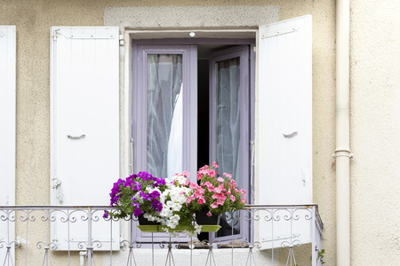 residential home: Window with flowers of a residential home in France