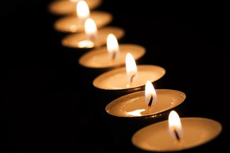 darkness: Burning tealights in darkness