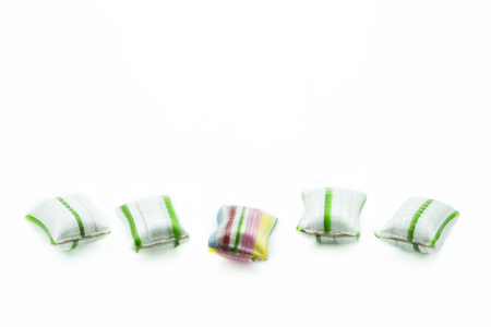 some: Five candies isolated on white