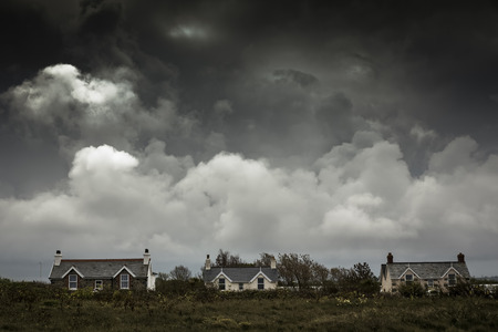 guernsey: Residential homes on Guernsey island, UK, with dramatic sky