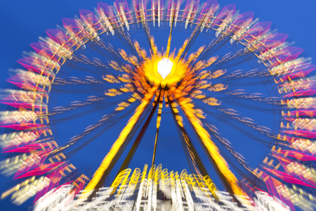 Big wheel on a fun fare, shot taken with intentional camera movement (ICM) Stock Photo