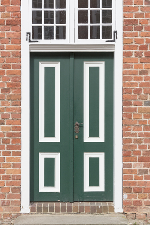 brick house: Old wooden door of a brick house, dutch style
