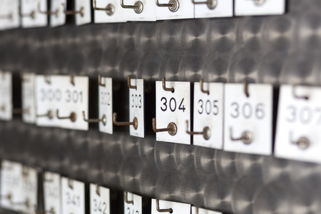 dof: Old locker tags with engraved numbers, shot with shallow DOF Stock Photo