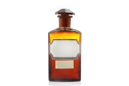 Vintage apothecary bottle with label on white background