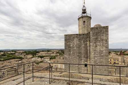 ochre: Looking over old tiled roofs of Uzes town in South France