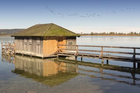 Boathouse on lake Kochelsee in Bavaria, Germany, in autumn