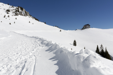 Hiking up to the Rotwandhaus shelter in the bavarian alps in winter