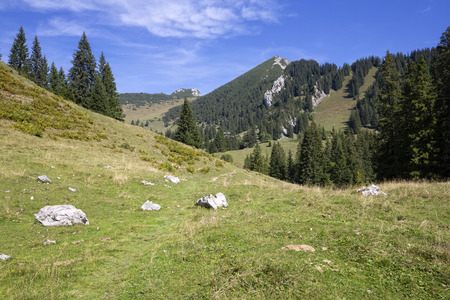 Hiking up to the Geigelstein peak, in the Tyrol mountains, Austria