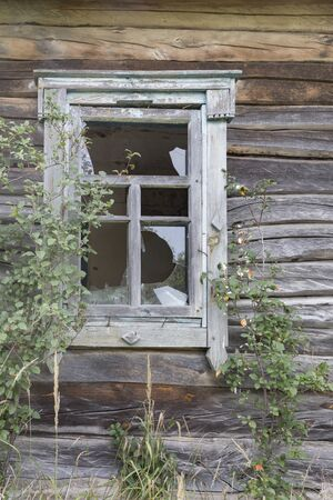 Window with broken glass on an abandoned home in the exclusion zone of Chernobyl in Belarus (White-Russia)