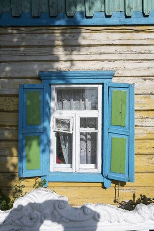 Window of an old residential home in a village in Belarus (White-Russia)