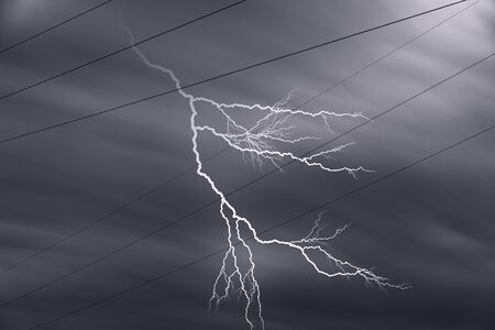 High voltage power line cables with lightning and dark sky Imagens