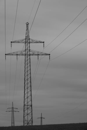 High voltage pylon with cables and dramatic sky Imagens - 148157274