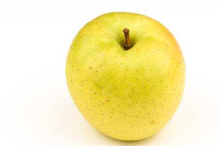 Ripe yellow apple on white background