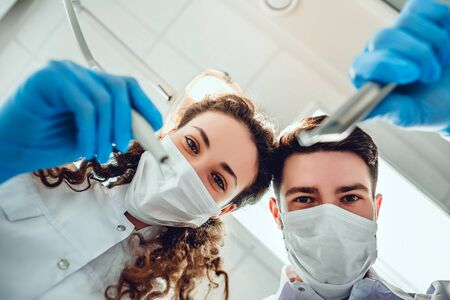Two dentists examining teeth, patients perspective. Close up view. 스톡 콘텐츠