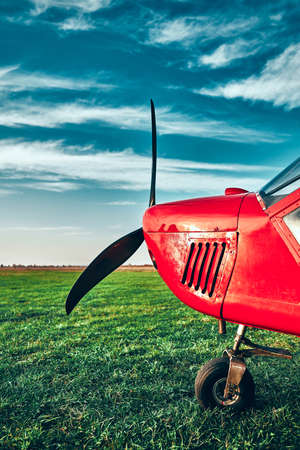 Small propeller airplain on the field. Vertical foto