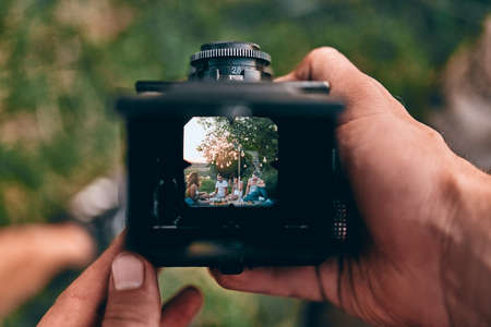 Photographer is making a photography with old camera. Top view. Stock Photo