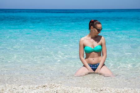 Pretty woman enjoying on Petani beach on Greek island Kefalonia