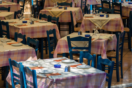 Lunch table settings in a Greek style restaurant