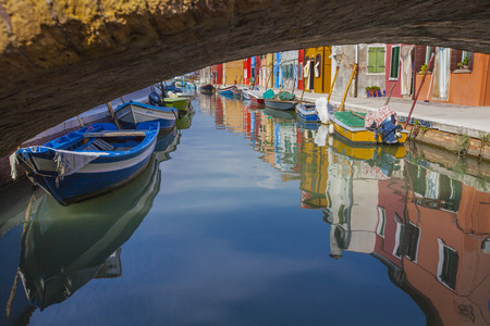 burano: Colored boats and houses in Burano Editorial