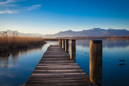 Early morning at a jetty at lake Chiemsee photo