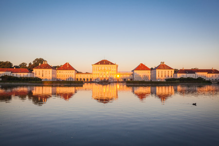 nymphenburg palace: Nymphenburg palace with reflection in the morning sunlight