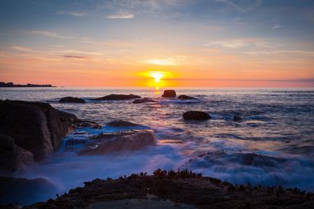 Ploumanach Cotes granites rose Brittany France sunset Standard-Bild