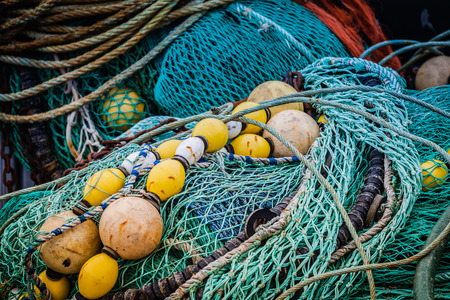 fishing equipment: Fishing nets and buoys in a harbor in Brittany
