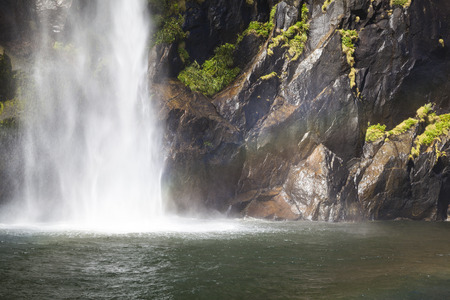 milford: Waterfall in Milford Sound New Zealand Stock Photo